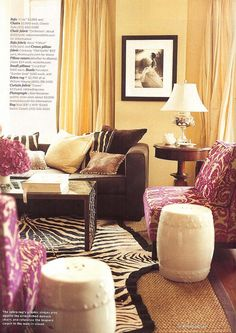 take note: the addition of the pink seating makes the room instantly girly (Domino April 2007 - Jennifer Marsico Apt by mscott218, via Flickr)