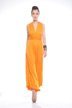 The Xaviera jumpsuit is a stunning and ultra sexy piece featuring a Y-back design and loose, full-length pant legs with pockets on either side, allowing you to feel comfortable in your own skin even when at a cocktail party. Comes in two color ways, Mud or Sunset.    40% Bamboo 60% Organic Cotton. Global Organic Textiles Standards (GOTS) and Organic Exchange (OE) certified.