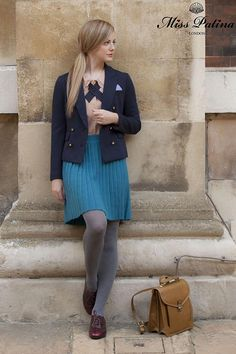Grey wool tights, pleated bright blue skirt and Hot Cross Buns blouse