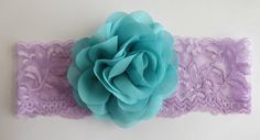 This adorable handcrafted baby headband features a 3 chiffon flower in mint. It is then placed on a 2 purple lace stretch elastic. A
