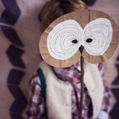 owl mask made with a branch & paper bag!