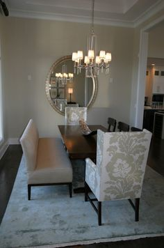 Suzie: Fowler Interiors - White & gray elegant formal dining room. love the wing back chairs at the head of tables & the bench