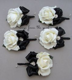 For mothers of the bride and grooms as well as grandmothers and special family members, these real touch rose corsages are accented with rhinestone and pearl buttons with black ribbon and can be custo