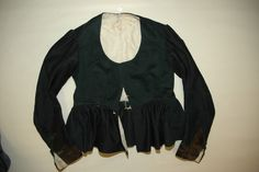 Rukketrøye i svart klede. - Rukketroye (jacket, I think) made in black cloth (wool). Two different types of fabric, since one has turned a bit green. There's velvet cuffs, and it's lined in cotton. Different Types Of Fabric, Cuffs, Velvet, Wool, Blouse, Board, Green, Cotton, How To Make