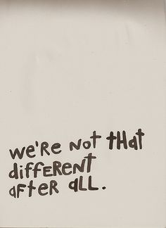 Image description: handwritten message on a blank white wall that says 'we're not that different after all'