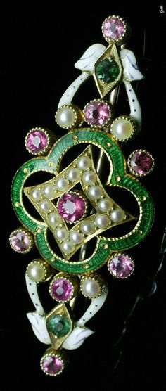 A Victorian Golden Jubilee brooch, British, circa 1887. Composed of tourmalines, seed pearls, guilloché enamel, enamel and 18K gold. Made in the year that marked Queen Victoria's Golden Jubilee. #GoldenJubilee #Victorian #brooch