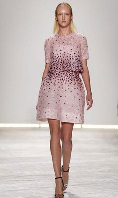 This Monique Lhuillier, with its pink color and floral appliques, is something that Adele would wear.
