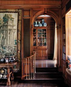 Love rooms with steps like this leading down to them.  -----------------------  Woody, arches, collections. Los Angeles, California | Ferguson & Shamamian........so elegant