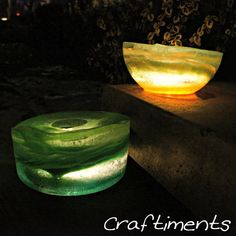 Ice lanterns to light your walkways. Craftiments shows how to make them, with swirls of food coloring.