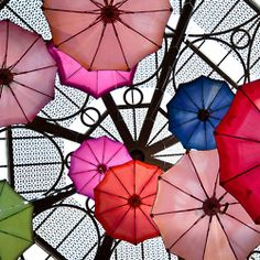 Umbrellas on the Ceiling.  Have seen this in several places...very effective idea. Especially nice in a child's room or play area. Love it!