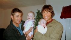 Jensen Ackles and Jared Padalecki holding babies