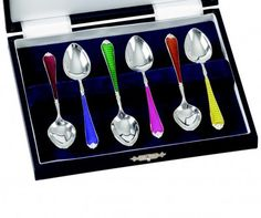 Silver Enamel Spoons. The difficult art of enamelling is shown to great effect in this set of coffee or tea spoons.  $