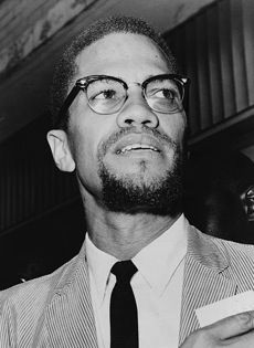 """Malcolm X wears the """"Browlines"""" -  eyebrow-esque plastic upper rims in the 1950s"""