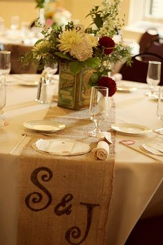 love the burlap table runners with initials