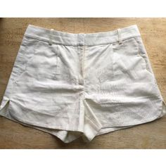 """JCrew Ivory Linen Scalloped Pocket Shorts This is a gorgeous pair of J.Crew size 2 ivory linen scalloped pocket shorts. Subtle pleating in the front (which manages to lay flat) and scoop scallop detail up the right side of the leg from hem. 3"""" inseam. They are a re-Posh and although they are beautiful they are honestly probably a bit too snug.  These are some mad beautiful bombshell shorts, but in a Audrey Hepburn could get away with this because these are really like a classy pair of…"""