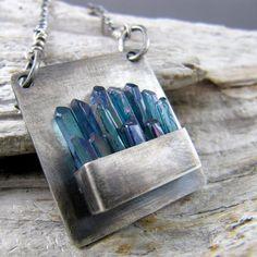Aqua Aura crystal necklace via ElementalAlchemist