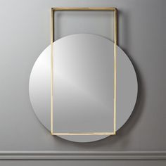 Free Shipping.  Shop Pendulum Gold Wall Mirror.   A circular mirror appears to hover mid swing in this standout design by Mermelada Estudio.