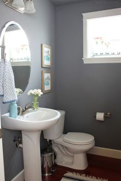 25 Decor Ideas That Make Small Bathrooms Feel Bigger Makeup Light And Shelves