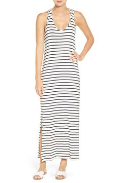 This classic striped maxi dress is updated with a twisted racerback and breezy side slits, making this chic style the perfect addition to the warm-weather wardrobe.