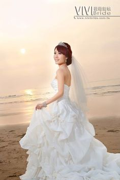 A soft and romantic photo of the bride with a beautiful sunset in the background.