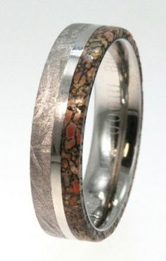 Believe it or not, the ring you see above was individually handcrafted by Jewelry by Johan, and contains real dinosaur bone, meteorite, and gold. According to the jeweler's website, the dino leg bone is sourced from the Morrison Formation in Utah and dates back at least 65-million-years to the Jurassic era.