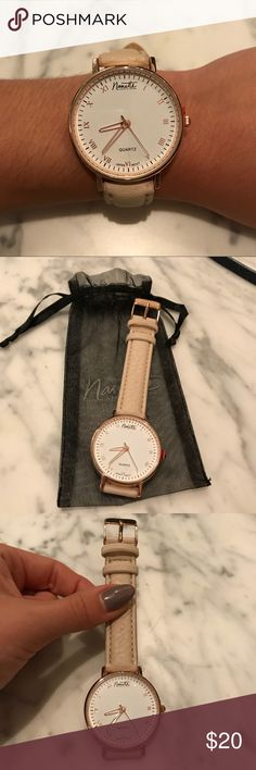 Nanette Lepore rose gold watch NWT Nanette Lepore rose gold watch NWT - cream/tan band. Perfect condition - neutral watch with hint of rose gold. Stickers still on the watch Nanette Lepore Accessories Watches