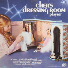 """Mego CHER - Cher's DRESSING ROOM Playset (1976) by Mego Corp. $899.99. Cher's Dressing Room Playset is a 1976 Mego Corp production. Box measures approx. 15-1/2"""" x 15-1/2"""" x 8-1/2"""". This is a BRAND NEW Set in the Original Box. The box tape on front is slightly yellowy, & split opened from old age. Everything in the box is SEALED. Set INCLUDES: a Black full length Leotard, a Wardrobe with Hangers, a Coffee Table, Couch, Magic Mirror, & 4 Double-Sided Magic Mirror Cards. On the Back..."""