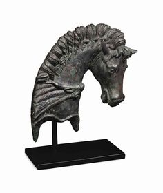 A ROMAN BRONZE FULCRUM TERMINAL  CIRCA 1ST CENTURY B.C.-1ST CENTURY A.D.