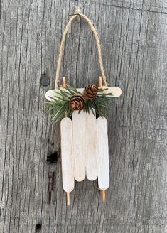 This cute rustic ornament is made from popsicle sticks. This cute sled design would make a wonderful ornament for the tree or decoration on a Christmas package. Thanks for looking and Merry Christmas Popsicle Stick Christmas Crafts, Popsicle Crafts, Christmas Ornaments To Make, Christmas Crafts For Kids, Craft Stick Crafts, Christmas Projects, Christmas Tree Decorations, Holiday Crafts, Popsicle Sticks