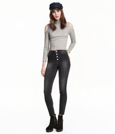 Pants in washed superstretch twill with a high waist and slim, ankle-length legs. Mock pockets at front, regular pockets at back, and visible button fly.