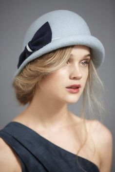 """Hairstyles To Wear With Cozy Winter Hats #refinery29  http://www.refinery29.com/winter-hat-hairstyles-tips-redken#slide-2  Cloche or Beret  """"I envision a girl in a cloche with her hair to one side, offsetting it with a messy bun that sits behind the ear,"""" says Cutler. """"Be sure to allow some hair to be seen from the front — this plays up the sort of effortless chic vibe of the Parisian girl who I see wearing this hat."""" When purchasing a more structured hat, Cutler says to look for one that…"""