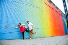 A lively engagement shoot at an ombre rainbow mural in DUMBO, Brooklyn. Photographed by Steadfast Studio.