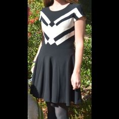 Diane von Furstenberg Holiday Black & Cream Dress Price negotiable. In perfect condition, worn once for photo, didn't even move in it, more photos if needed. Black and light ivory/cream, skater like skirt, one piece dress. True 8. Price negotiable. Diane von Furstenberg Dresses