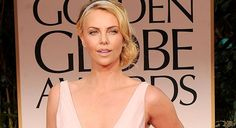 Charlize Theron Hired to Ride Struggling Cleveland Light Rail System Monday through Friday.  --     The Onion 2/15/2012