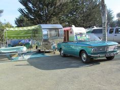 Convertible BMW with Vintage trailer