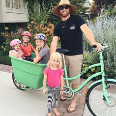 """You know what they say?... The best dad's make the hottest husbands😍@kevin_kirkland"" @jenmk  #hothusbands #bestdads #madsenbike #seafoamgreen #dad #madsencycles #bucketbike #provo #utah #familyfun #summer"
