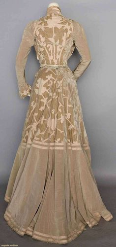 """VELVET & WOOL AFTERNOON GOWN, c. 1902 (back view) 2-piece, taupe moire silk faille & velvet w/ faun wool flannel appliques in stylized folige motifs, bolero style bodice, high neck """"under bodice"""" of cream silk panne, ribbon embroidered & lace trimmed lapels, lace jabot, B 32"""", W 24.5"""", Skirt L 40""""-46"""""""