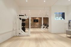 Nice spacious home gym with wood floors. Not sure if this is private residence or not. Still very nice