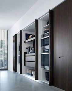 Image result for concealed kitchen with pocket book doors