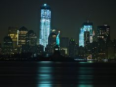 Statue of Liberty and new Freedom Tower in lower manhattan around 4:00 AM  3.26.12