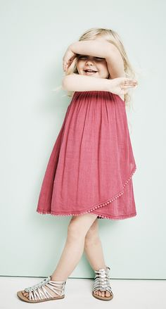 Put your sweet pea in a gauzy tulip-hem dress. It's lightweight, airy and made for the popsicle-melting heat. Pair it with fun statement sandals that she loves showing off and you won't worry about her losing. Going somewhere a bit fancier? Rotate in classic Mary Janes for a dressier vibe.