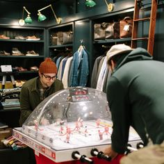 Our bubble hockey table is always available for pick-up games.