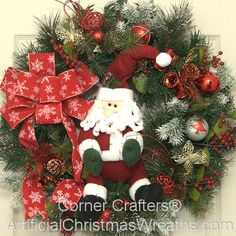 Santa Christmas Wreath - 2013 - Our Santa Christmas Wreath is made of a full artificial pine wreath base with colorful decorations and a traditional Santa. The wreath is finished with a lovely over-sized bow. It will add a touch of old fashioned Holiday charm!  #ChristmasWreaths #XmasWreaths #Wreaths #SantaWreath #Santa