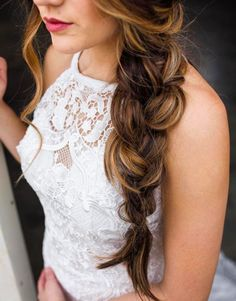 We are in love with a loose soft braid adorning our Morilee by Madeline Gardner Maybelle Gown. The contrast of lace on the high neck, halter bridal gown is perfect against the cascading curl in this wedding hair style. Feeling major beach and boho vibes. Style 6851. Photo by Allison Mitchell Photography.