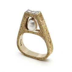 Grima | Swinging Pearl Ring, 1969  A Pearl swinging from a Yellow Gold Ring set with Diamonds