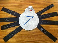 THE NUMBER SPIDER!!   I had each student choose a number 2-10, and we wrote it on the spiders tummy.  Then we folded a black sheet of construction paper 3 times to make some legs and cut them out.  Then one by one, we wrote 8 different ways to make the number we chose to write on the tummy.