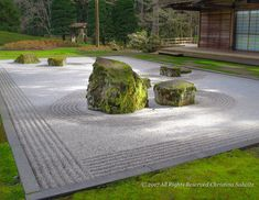 This handsome zen garden demonstrates how you can view it from four sides and have a completely different interpretation of what it represents with each passing angle. One step forward and you migh… Zen Rock Garden, Garden Stones, Garden Paths, China Garden, Japan Garden, Contemporary Landscape, Landscape Design, Dubai Garden, Japanese Garden Design