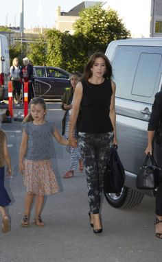 Princess Isabella with mom Crown Princess Mary at a a One Direction concert, Copenhagen, June 16, 2014