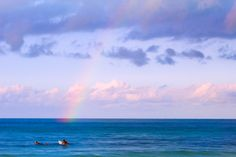 Sunset surfing with rainbows doesn't get much better than this