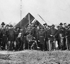 Garry Adelman's Civil War Page. You rarely see this version of the photo of General Meade and his staff in 1864. In the more commonly seen version, he is hatless. A great shot in any event that gives a good idea of how many staff officers a commander could have!